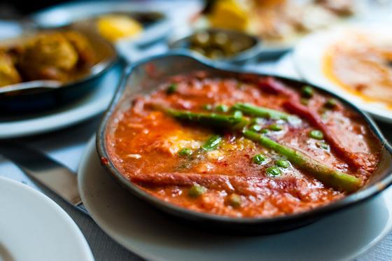 Baked eggs, asparagus, tomato, italian sausage